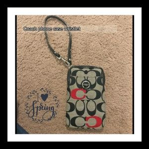 Coach iPhone 5 wristlet. Has room for cards also